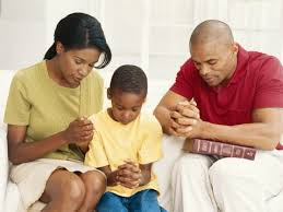 Praying Black Family